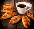 Stuffed croissants homemade mini and dark coffee Stock Image