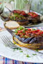 Stuffed eggplant aubergine with vegetables in white plate Stock Image