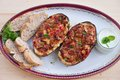 Stuffed Eggplant halves with tomato onion sweet pepper and cheese. Royalty Free Stock Photo