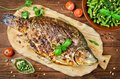 Stuffed fish cooked on bbq Royalty Free Stock Photo