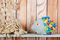 Stuffed funny fish on wooden background Royalty Free Stock Photo