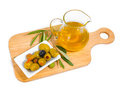 The stuffed olives branches and olive oil are on a chopping board isolated Stock Photos