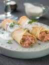Stuffed pancake with salmon and sauce selective focus Stock Image
