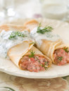 Stuffed pancake with salmon and sauce selective focus Stock Images
