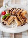 Stuffed pancakes sweet with chocolate sauce selective focus Royalty Free Stock Image