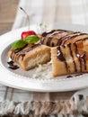 Stuffed pancakes sweet with chocolate sauce selective focus Stock Photography