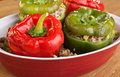 Stuffed peppers in a red dish Stock Photos