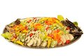 Stuffed pike isolated sliced decorated with tomato lemon and cucumber on white Royalty Free Stock Image