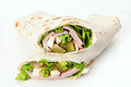 Stuffed pita bread with meat cheese pickles green salad on white background Stock Photo