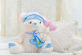 Stuffed teddy bear toy with hearts and pillows Stock Image