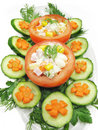 Stuffed tomato with cucumber and carrot Royalty Free Stock Photos