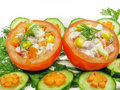 Stuffed tomato with cucumber and carrot Stock Image