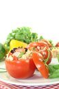 Stuffed tomatoes with pasta salad and basil on a light background Royalty Free Stock Photography
