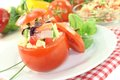 Stuffed tomatoes with pasta salad and cress chives on a light background Royalty Free Stock Photos