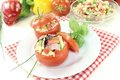 Stuffed tomatoes with pasta salad and cress on a light background Royalty Free Stock Images