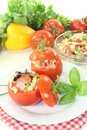 Stuffed tomatoes with pasta salad on a light background Stock Photos
