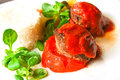 Stuffed tomatoes with rice on a white plate Royalty Free Stock Photo