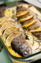 Stuffed trout with lemon dish delicious of fish onion basil and herbs decorated Stock Photo