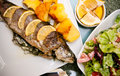 Stuffed trout with lemon dish delicious of fish onion basil and herbs decorated Royalty Free Stock Image