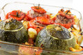 Stuffed vegetables transparent plate with cooked tomatoes and marrows with minced meat with sauce Stock Photos