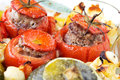 Stuffed vegetables transparent plate with cooked tomatoes and marrows with minced meat with sauce Stock Photo