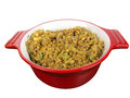 Stuffing in red bowl cornbread a cooking isolated on white background Stock Photos