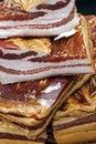 Stukken van gerookt varkensvleesbacon Stock Afbeeldingen