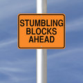 Stumbling blocks ahead a road sign warning of Stock Photo