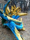 Stump street art in kiev painting like ukranian flag Stock Image