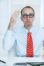 Stunned man with big glasses and a red tie at work like a comedi comedian bookkeeper or manager good ideas hands up Royalty Free Stock Photo