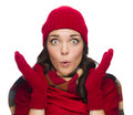 Stunned mixed race woman wearing winter hat and gloves expressive isolated on white background Royalty Free Stock Images