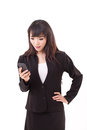 Stunned surprised exited businesswoman looking at smartphone news application message update via Stock Images