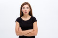 Stunned wondered beautiful young woman with crossed arms Royalty Free Stock Photo