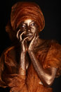 Stunning african amercian woman painted with gold Royalty Free Stock Photos