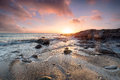 Stunning beach sunset over hemmick on the south coast of cornwall Royalty Free Stock Photography