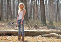 Stunning blonde female archer young woman in white tank top and jeans preparing to shoot a compound bow archery Stock Images