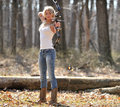 Stunning blonde female archer young woman in white tank top and jeans preparing to shoot a compound bow archery Royalty Free Stock Photos