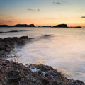 Stunning landscape dawn sunrise with rocky coastline and long exp over beautiful in mediterranean sea Royalty Free Stock Photos
