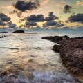 Stunning landscape dawn sunrise with rocky coastline and long exp over beautiful in mediterranean sea Stock Photography