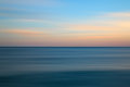 Stunning long exposure seascape image of calm ocean at sunset beautiful Stock Photo