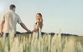 stunning sensual young couple in love posing in summer field holding hands Royalty Free Stock Photo