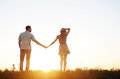 Stunning sensual young couple in love posing in summer field at Royalty Free Stock Photo