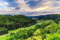 Stunning summer evening landscape in the rural countryside of ba bavaria germany lovely hills and woods franconian switzerland Stock Photos