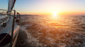 Stunning sunset with a yacht in the Aegean sea. Travel. Royalty Free Stock Photo