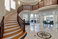 Stunning two story entry foyer with marble mosaic tiled floor Royalty Free Stock Photo