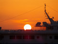 Stunning View of the Setting Sun over the Yacht at the Old Port of Mykonos town, Greece Royalty Free Stock Photo