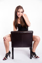 Stunning young beautiful barefoot woman straddles black leather shot from above straddling common chair Stock Photos