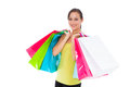 Stunning young woman carrying shopping bags portrait of against white background Stock Images