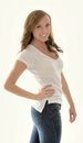 Stunning young woman in white t-shirt and jeans - Royalty Free Stock Photo