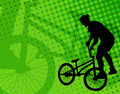 Stunt bicyclist on the abstract background silhouette green Stock Photography